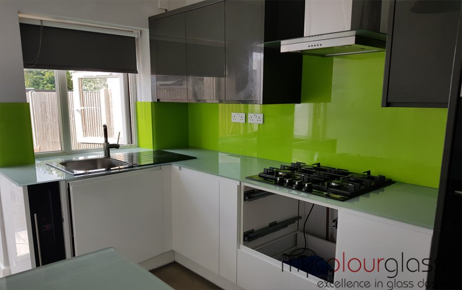 Green splashnack with glass worktop
