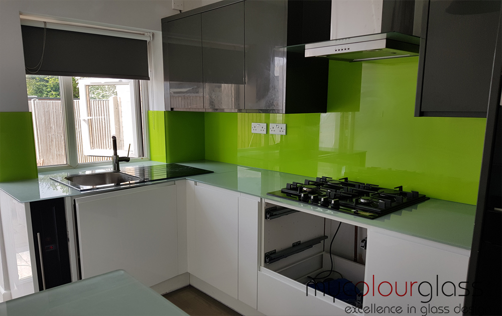 Green splashnack with glass worktop