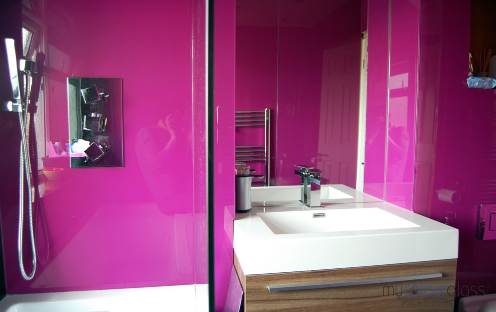 Pink glass bathroom and mirror